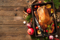 Christmas roast duck with apples and oranges on baking tray Stock Photography