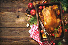 Christmas roast duck with apples and oranges on baking tray Royalty Free Stock Photography