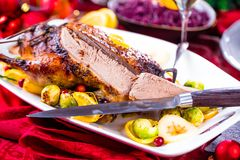 Christmas roast duck served on a festive table stock photo