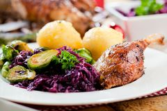Christmas roast duck served on a festive table royalty free stock image