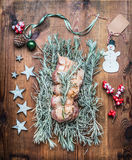 Christmas roast preparation on wooden background with festive decoration Royalty Free Stock Photography