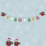 Christmas robins. Blue snowflake background with christmas robins and decorations Stock Photo