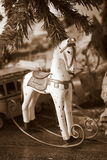 Christmas rocking Horse. Rocking horse with gift package, xmas tree and toys Royalty Free Stock Images