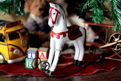 Christmas rocking horse. Rocking horse with gift package, xmas tree and toys.A childhood christmas toys holidays vintage Royalty Free Stock Photography