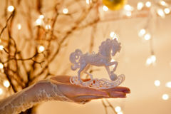 Christmas Rocking Horse Ornament. With beautiful magic lighting stock photo