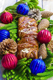 Christmas roll Yule log with caramel and almonds.  Royalty Free Stock Images