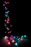 Christmas romantic decorative garland lights frame on black background with copy space Stock Photos