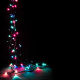 Christmas romantic decorative garland lights frame on black background with copy space Stock Photography