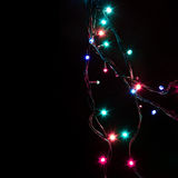 Christmas romantic decorative garland lights frame on black background with copy space Royalty Free Stock Photo