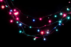 Christmas romantic decorative garland lights frame on black background with copy space Royalty Free Stock Image