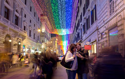 Christmas in Rome. December 9, 2013: Christmas lights and people on Via del Corso in Rome, Italy Royalty Free Stock Images