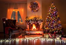 Beautiful decorated living room with a christmas tree and a fire place. Christmas room beautiful decorated, warm with fire place , christmas tree and many lights royalty free stock photos