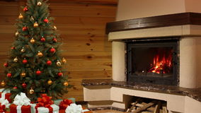 Christmas room. Christmas tree by the fireplace stock video