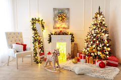 Christmas Room Interior Design. Xmas Tree Decorated By Lights Presents Gifts Toys, Candles And Garland Lighting Indoors stock image