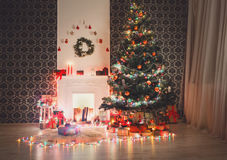 Christmas room interior design, decorated tree in garland lights Stock Photo