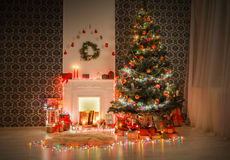 Christmas room interior design, decorated tree in garland lights. Christmas living room illumination. Beautiful xmas lights garland, decorated christmas tree Royalty Free Stock Photography