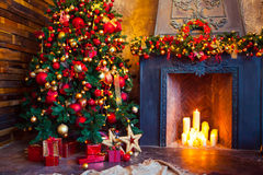 Christmas Room Interior Design, Xmas Tree Decorated By Lights Pr. Esents Gifts Toys, Candles And Garland Lighting Indoors Fireplace Royalty Free Stock Photo