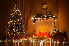 Christmas Tree Fireplace Lights, Decorated Xmas Living Room, Night Interior royalty free stock image