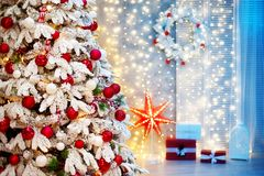 Christmas room interior. Christmas tree decorated with balls and bows, with gifts Stock Image