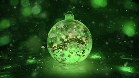 Christmas Rotating Green Ice Glass Bauble snow colorful petals background loop