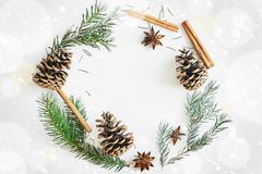 Christmas and New Year round frame composition. Fir branches with cones, star anise, cinnamon on white background. Christmas round frame composition. Fir stock photos