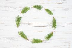 Christmas Round Frame with fir tree, on rustic wood. Christmas Round Frame with fir tree, on rustic white wood background royalty free stock photo