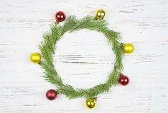 Christmas Round Frame with fir tree, on rustic wood, copy space for text.  royalty free stock images