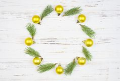Christmas Round Frame with fir tree, on rustic wood, copy space for text. New Year background.  royalty free stock images