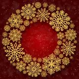 Christmas round frame with gold snowflakes on a red background. Border of sequin confetti. Glitter powder sparkling background royalty free stock photo