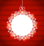 Christmas round frame made in snowflakes on red wooden backgroun Stock Photos