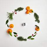 Christmas Round Frame. From Natural Branches and Tangerines. Flat Lay royalty free stock photography