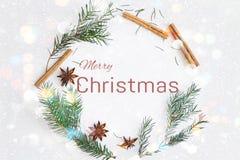 Christmas round frame wreath card with text merry christmas. Fir branches, star anise, cinnamon on pastel blue background. Christmas round frame wreath card with royalty free stock photos