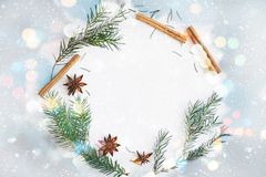 Christmas and New Year round frame wreath composition. Fir branches, star anise, cinnamon on pastel blue background. Christmas round frame wreath composition royalty free stock photo