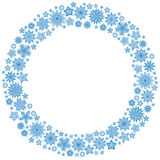 Christmas round frame or wreath of snowflakes Stock Images