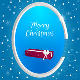 Christmas round tag with long red box and white bow on a blue background with snowflakes. Suitable for web design, postcards, invi Stock Images
