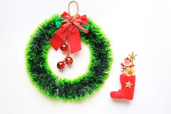 Christmas round wreath with Red boot and little Santa on white background.  stock photos