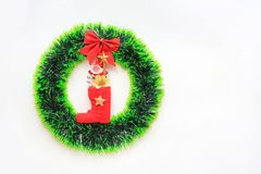 Christmas round wreath with Red boot and little Santa on white background.  royalty free stock photos