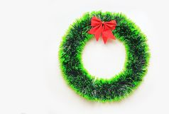 Christmas round wreath with red ribbon on white background.  royalty free stock image