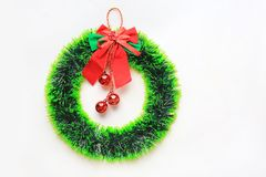 Christmas round wreath with ribbon and red ball hanging on white background.  stock photos