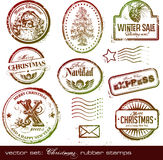 Christmas rubber stamps. Set of grungy retro Christmas postage stamps with angel, Santa Claus and Christmas tree Stock Photos