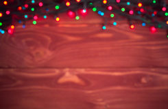 Christmas rustic background - vintage planked wood with lights a stock image