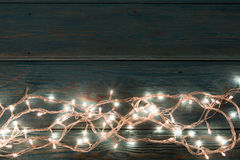Christmas rustic background - vintage planked wood with lights and free text space Royalty Free Stock Images