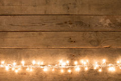 Christmas rustic background - vintage planked wood with lights and free text space. Christmas rustic background  vintage planked wood with lights and free text Stock Photography