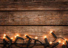 Christmas rustic background - vintage wood with lights royalty free stock photography