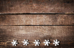 Christmas Rustic Background With White Snowflakes And Free Text Royalty Stock Photos