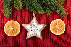Christmas Rustic Decoration On Red Knitted Fabric Background Royalty Free Stock Photography