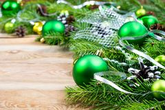 Christmas background with green baubles and silver ribbon stock images