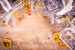 Christmas rustic light boxes, slices of dried orange, spices. Royalty Free Stock Photos