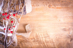 Christmas rustic light boxes, snowy wreath, berries. Stock Image