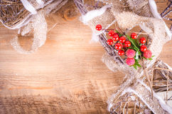 Christmas rustic light boxes on wooden background, berries Royalty Free Stock Photos